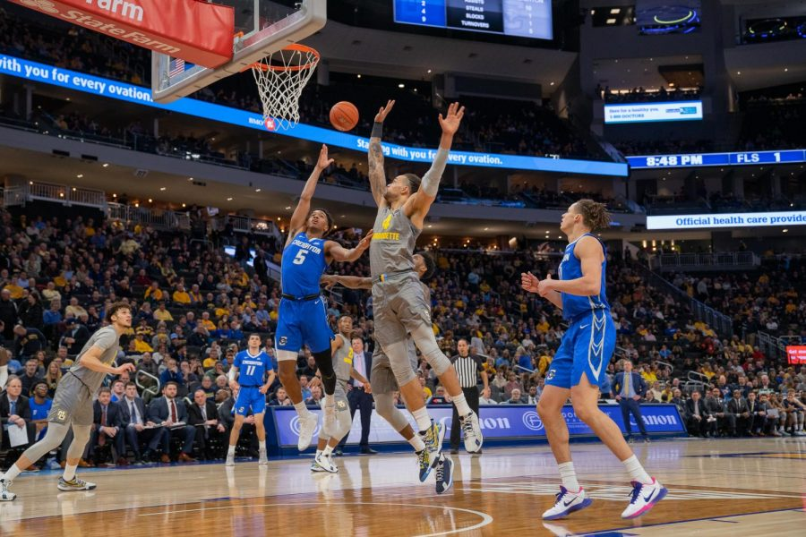 Theo John (4) goes up for a block against Creighton's Ty-Shon Alexander (5) in Marquette's 73-65 loss Tuesday night.