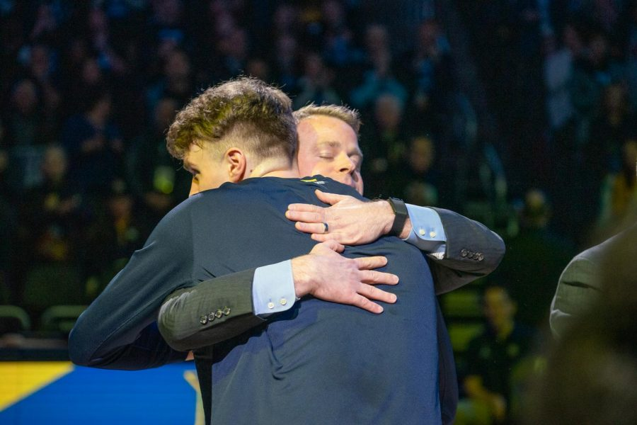 Head coach Steve Wojciechowski hugs Jayce Johnson during the Senior Day ceremony prior to the game.