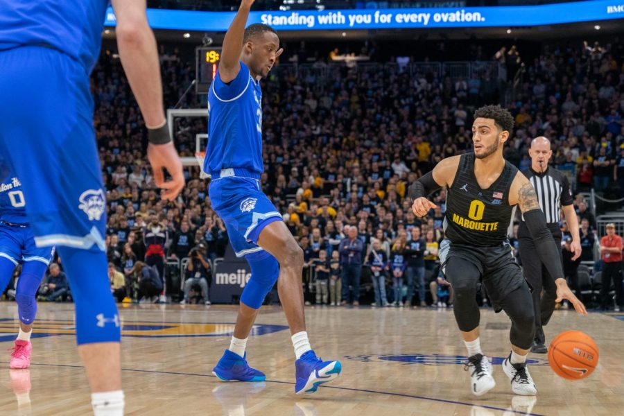 Markus Howard (0) dribbles the ball in Marquette's loss to Seton Hall Feb. 29.