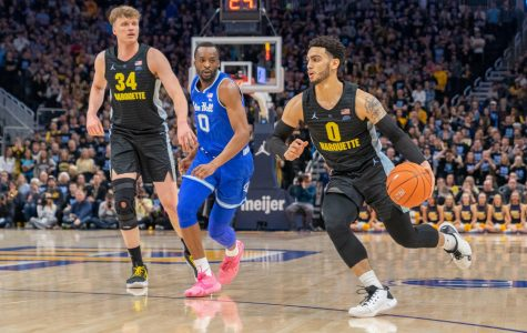 Markus Howard (0) dribbles the ball past a Seton Hall defender in Marquette's 88-79 loss against the Pirates.