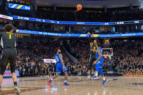 Markus Howard (0) attempts a 3-pointer in Marquette's 88-79 loss against No. 13 Seton Hall Feb. 29 at Fiserv Forum.