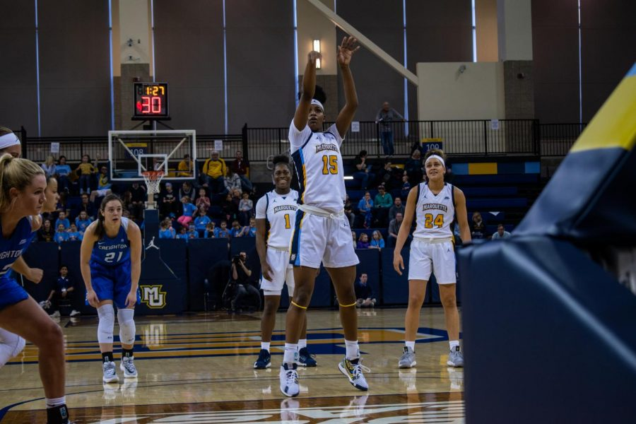 Camryn Taylor (15) shoots a free throw in Marquette's 52-50 win over Creighton Sunday.