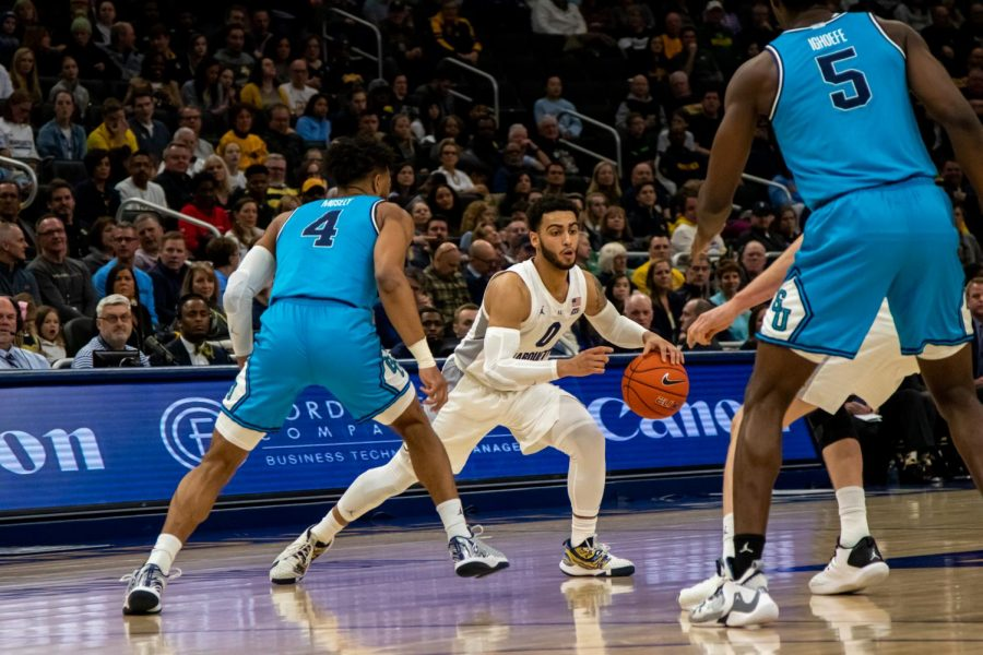 Markus Howard (0) dribbles the ball in Marquettes 93-72 win over Georgetown Wednesday night.