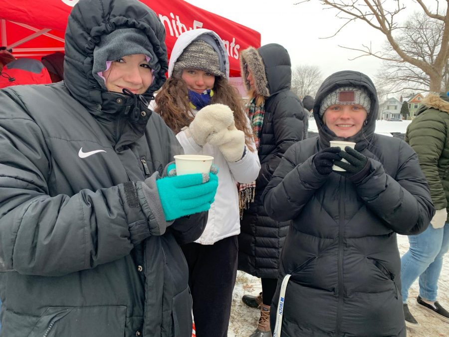 Students+from+Alpha+Omega+Epsilon+are+bundled+up+in+the+cold+weather+to+help+at+the+Milwaukee+Cocoa+Classic+5K+event.