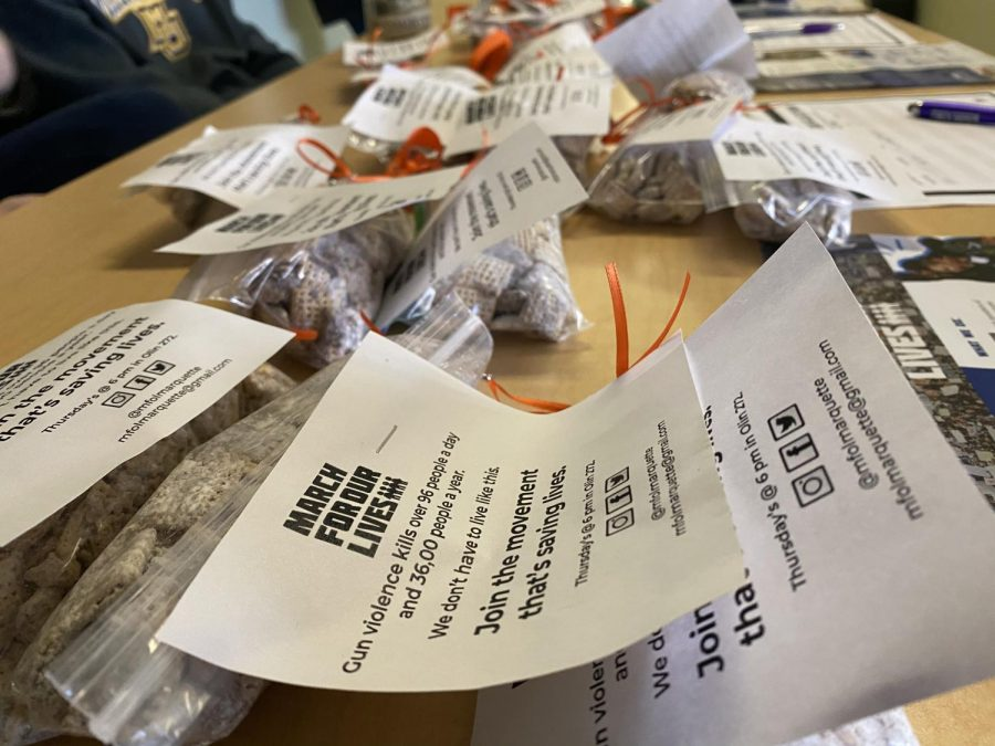Puppy Chow sold at the March for Our Lives bake sale with statistics on gun violence and an orange ribbon, representing gun violence awareness.