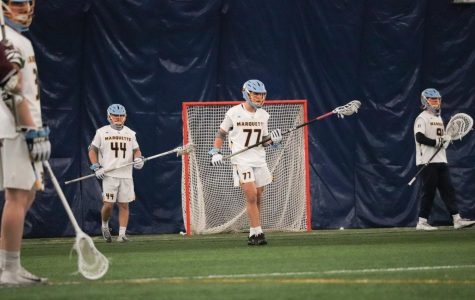 Mason Woodward (77) warming up in Marquette 11-10 win over Bellarmine on Feb. 8.