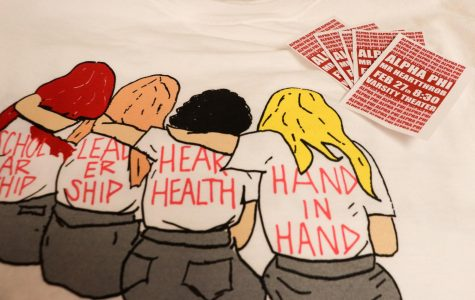 Mr. Heartthrob's T-shirt displays values related to Alpha Phi's philanthropy, which focuses on women's heart health.