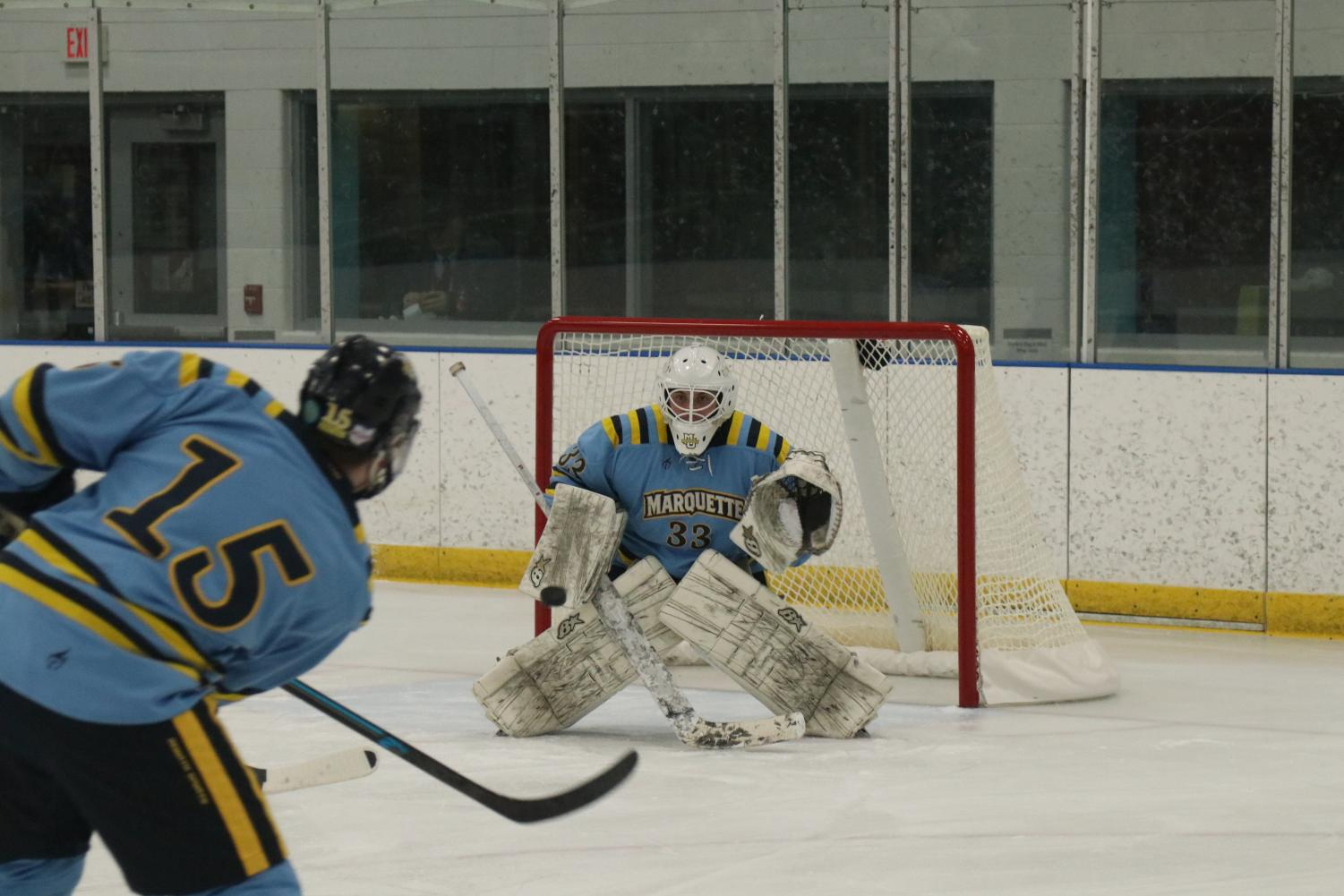 Jimmy Bertane (33) attempts to block a shot in Marquette club hockey's win over Bradley Friday night.