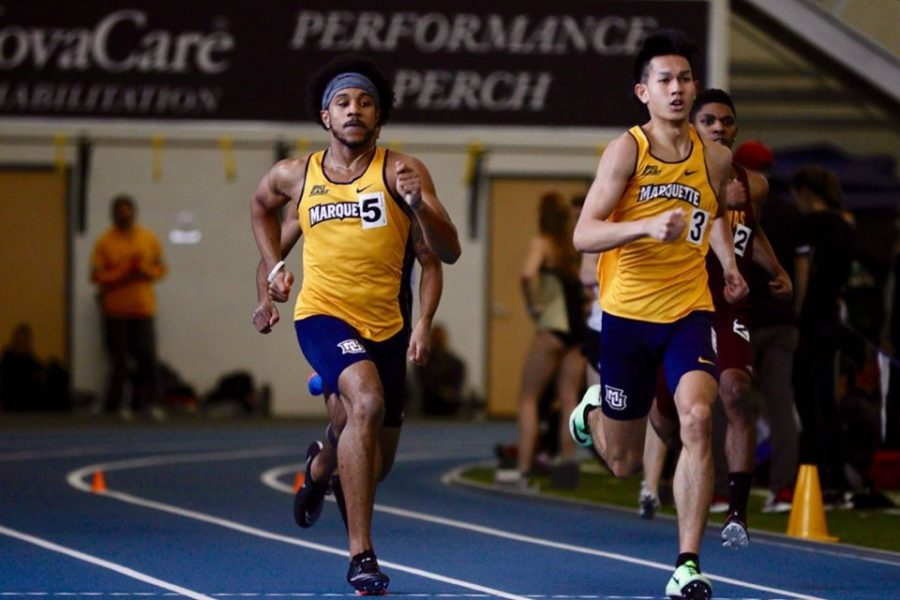 Julian Wright (left) runs in the Grand Valley State University meet on Feb.14. He broke the school record in the 400 meter dash.  (Photo courtesy of Marquette Athletics.)