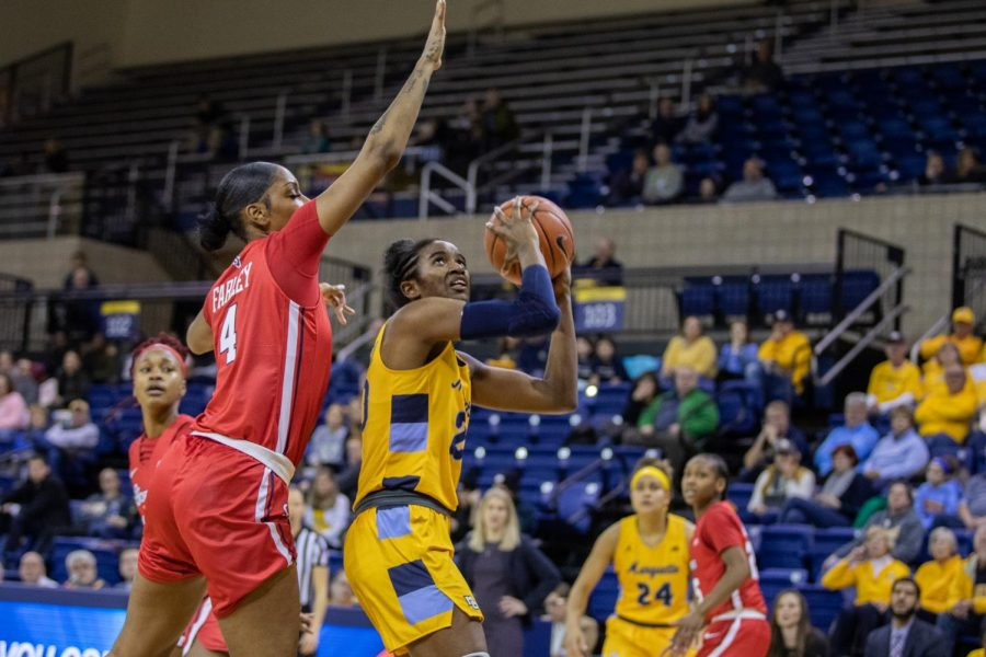 Altia Anderson (20) goes up for a layup in Marquette's 94-85 victory over St. John's Jan. 10.