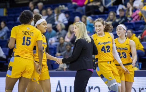 Megan Duffy congratulates her team for its 57-52 win over Villanova