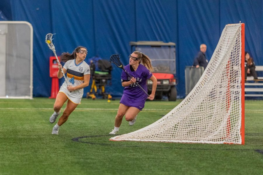 Carolien Steller (4) heads around the net to attempt a pass in Marquette's 16-6 win over Niagara on Feb.23.
