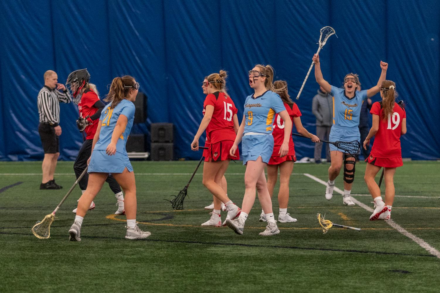 Megan Menzuber (9) celebrates after scoring a goal in Marquette's 17-6 win over Cincinnati. She led the team with six goals, tying a program high for most goals in a game.