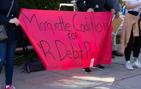 The Marquette Coalition for Debt Relief protested Marquette's involvement with Baupost.   Marquette Wire Stock Photo