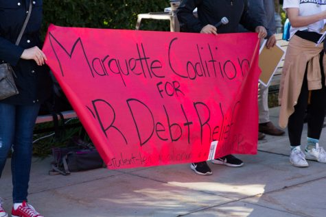 The Marquette Coalition for Debt Relief protested Marquette