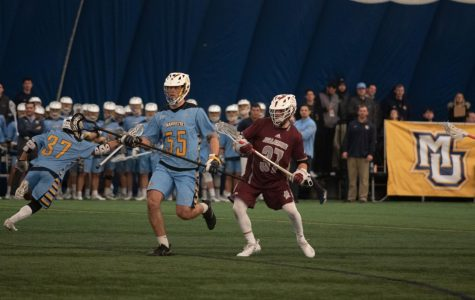 Noah Richard (55) runs in Marquette's 15-9 win  against Bellarmine Feb. 9, 2019. (Marquette Wire stock photo.)
