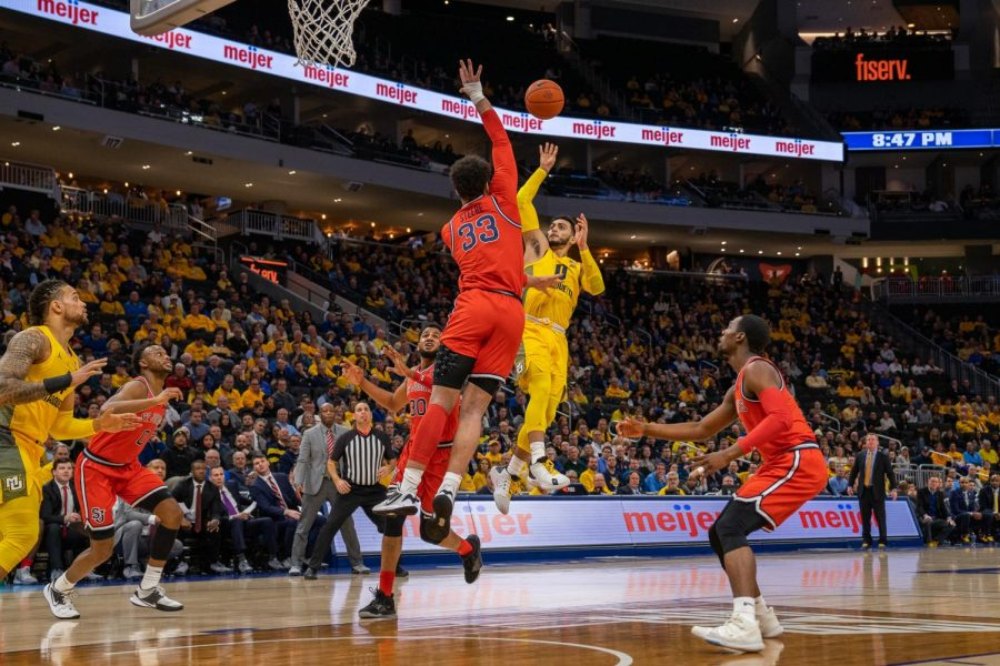 Markus Howard (0) attempts a shot in Marquette's win over St. John's Jan. 21 at Fiserv Forum.