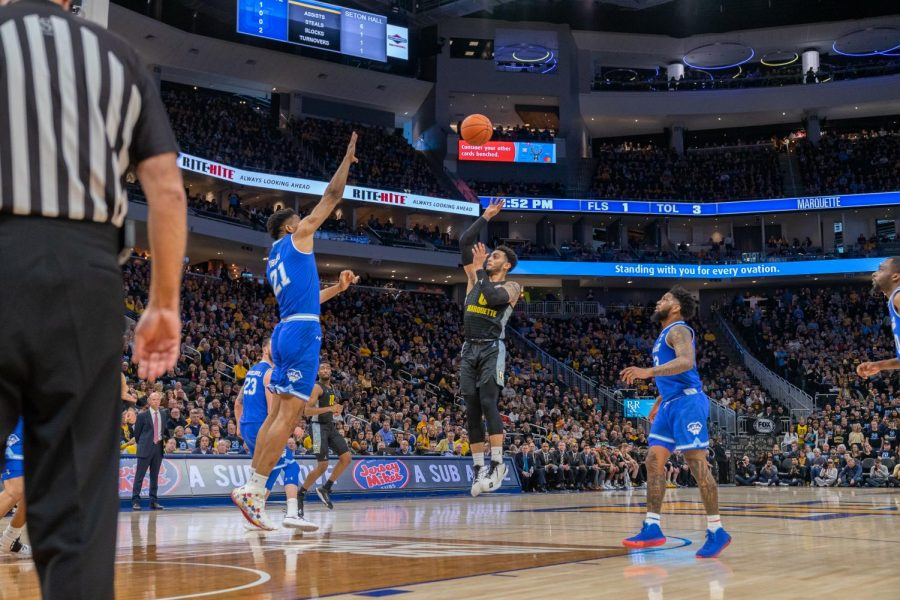 Markus Howard (0) attempts a jumper in Marquette's loss to Seton Hall Feb. 29 on Senior Day.