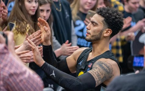 Markus Howard (0) high-fives fans after his final game at Fiserv Forum Feb. 29.