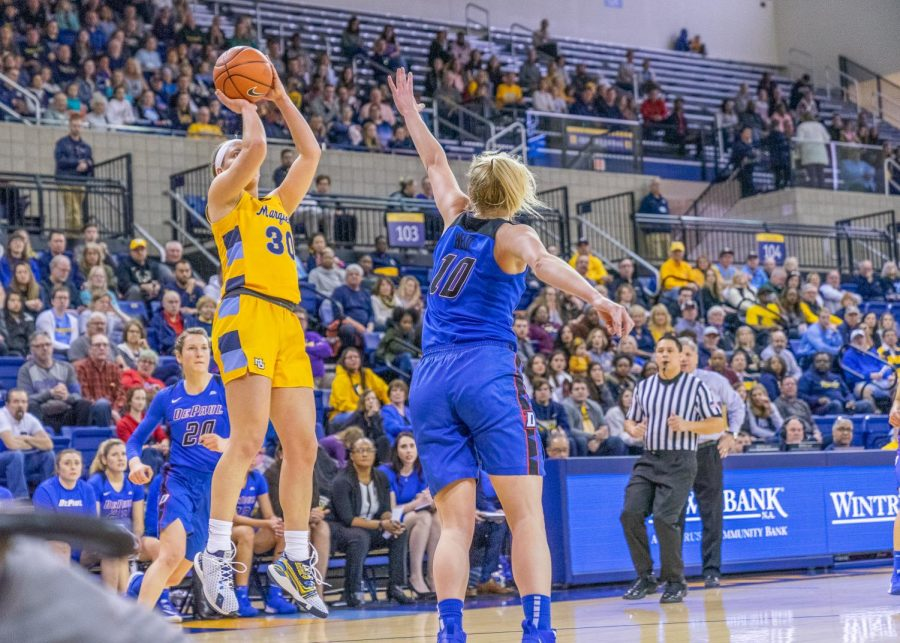Isabelle Spingola (30) shoots a jumper in Marquettes 90-83 win over DePaul on March 1.