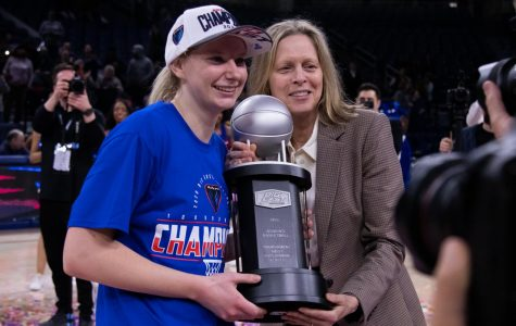Lexi Held (left) poses with BIG EAST Commissioner Val Ackerman (right) when receiving her trophy for BIG EAST Tournament Most Outstanding Player.