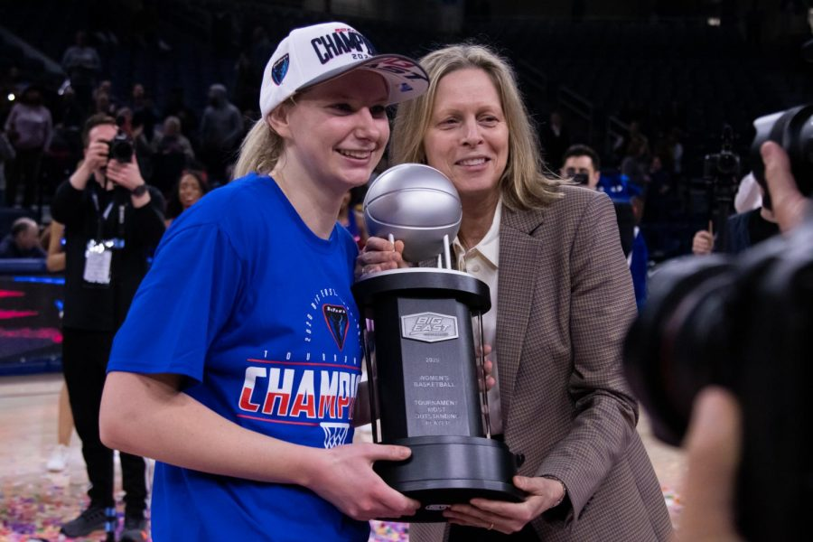 Lexi+Held+%28left%29+poses+with+BIG+EAST+Commissioner+Val+Ackerman+%28right%29+when+receiving+her+trophy+for+BIG+EAST+Tournament+Most+Outstanding+Player.