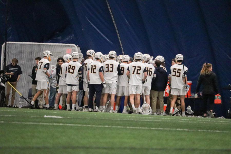 Marquette men's lacrosse huddles Feb. 15.
