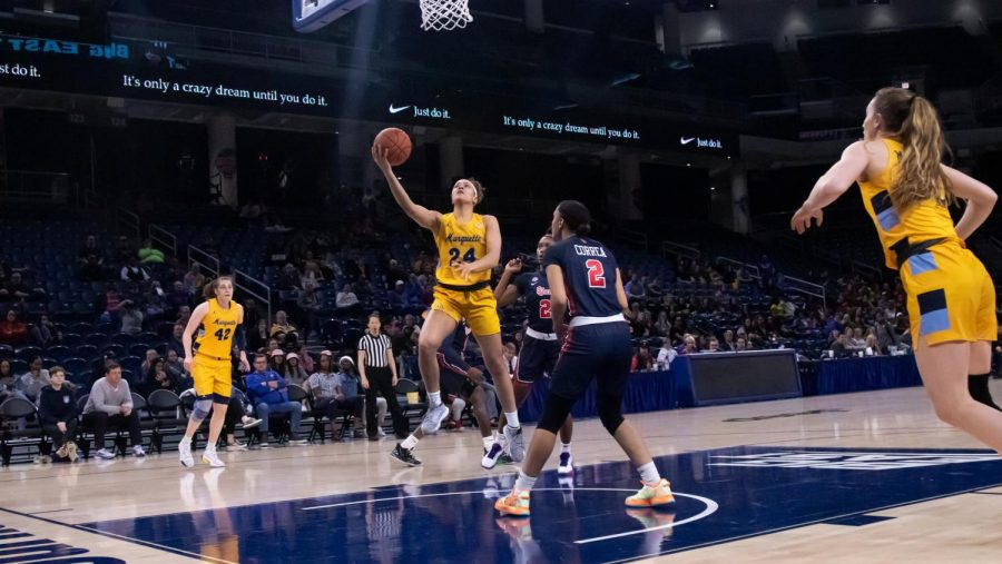 Selana Lott (24) goes up for a layup in Marquette's 78-55 win over St. John's in the BIG EAST Semifinals. Lott led the Golden Eagles with 18 points.
