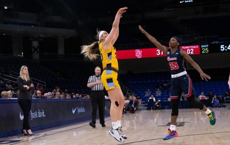 Isabelle Spingola (30) attempts a jump shot in Marquette's 78-55 victory over St. John's.