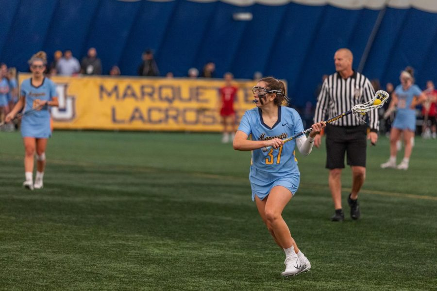 Lydia Foust (37) looks up field in Marquette's 17-6 win against Cincinnati on Feb.14.