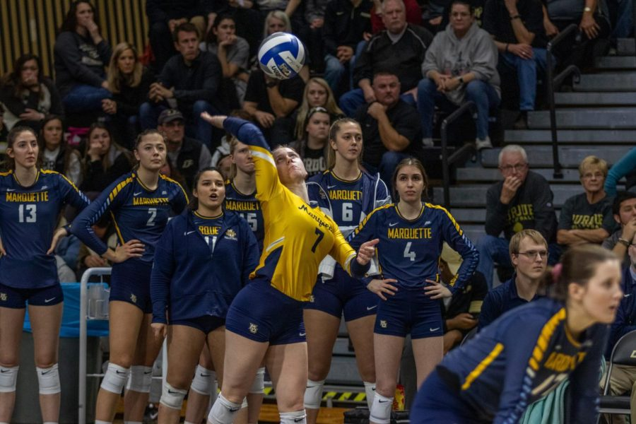Martha Konovodoff (7) attempts a serve in Marquette's loss to Purdue in the NCAA Tournament Dec. 7, 2019.
