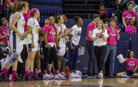 Megan Duffy walks up the sideline in Marquette's 76-54 win over Butler on Feb. 16 on Play4Kay Day.