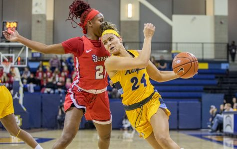 Selena Lott (24) drives to the basket with a St. John's defender coming on in Marquette's 94-85 win Jan. 10.
