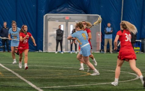 Megan Menzuber (9) shoots the ball in Marquette's 17-6 win over Cincinnati on Feb.14.