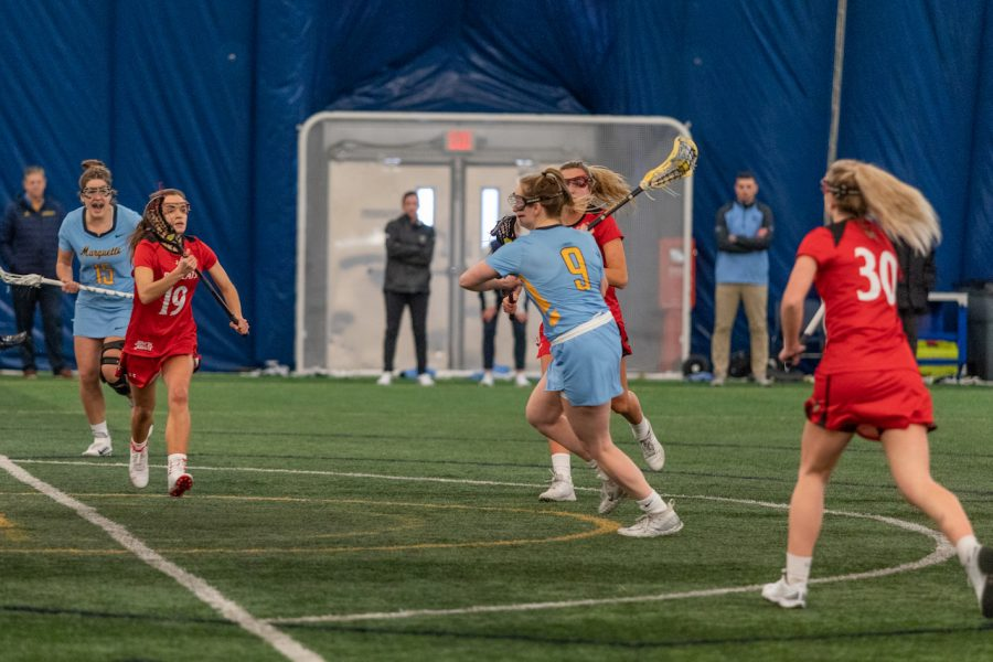 Megan Menzuber (9) shoots the ball in Marquette's 17-6 win over Cincinnati on Feb.14.