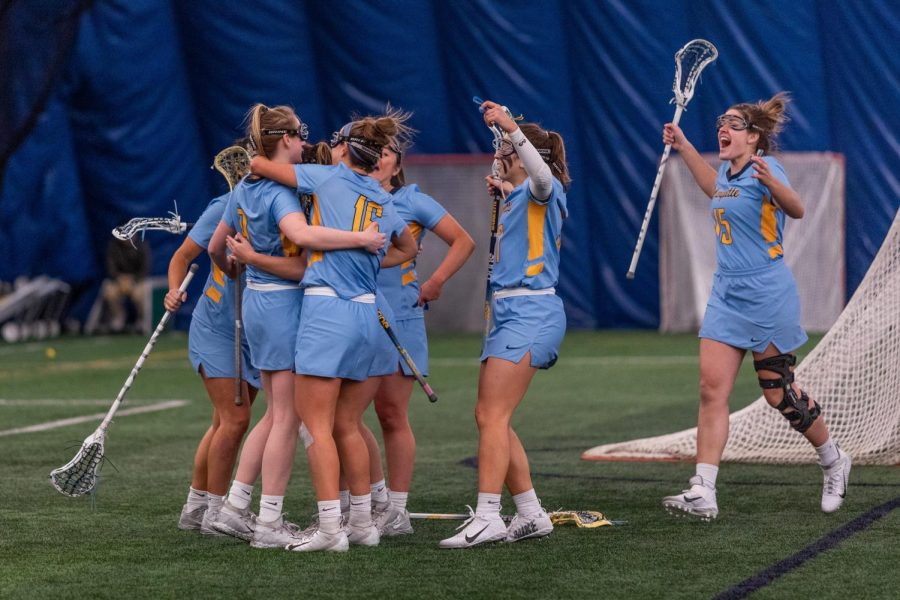 Marquette women's lacrosse celebrates during their 17-6 win over Cincinnati Feb. 14.