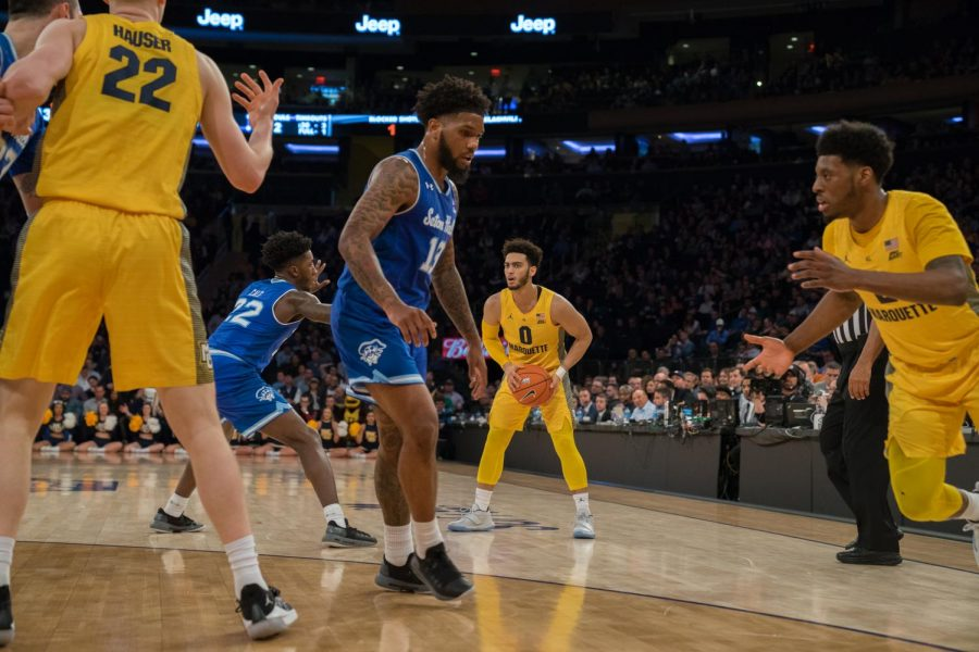Markus Howard (0) looks to pass to a teammate in Marquettes loss to Seton Hall in the BIG EAST Semifinals March 15, 2019.