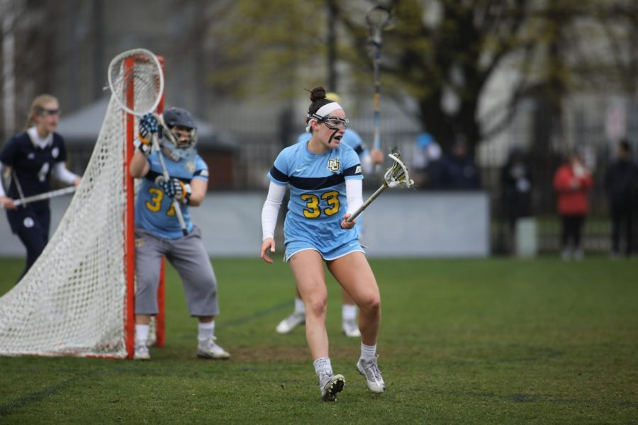 Erin Dowdle (33) owns the sixth-most draw controls in program history. (Photo courtesy of Marquette Athletics.)