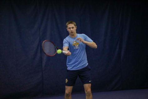 Alex Warstler attempts a forehand at practice in 2020. (Photo courtesy of Marquette Athletics.)