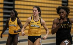 Breanne Marchan (center) runs at University of Wisconsin-Milwaukee Feb. 22. (Photo courtesy of Marquette Athletics.)