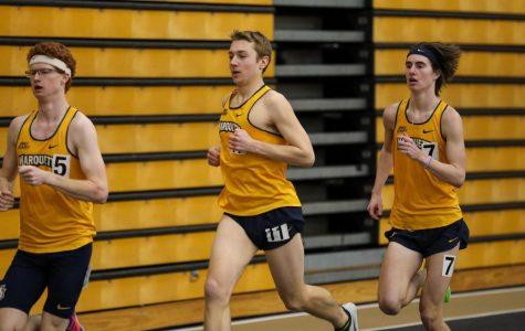 Matt Cavanaugh (11) runs at University of Wisconsin-Milwaukee Feb. 22. (Photo courtesy of Marquette Athletics.)