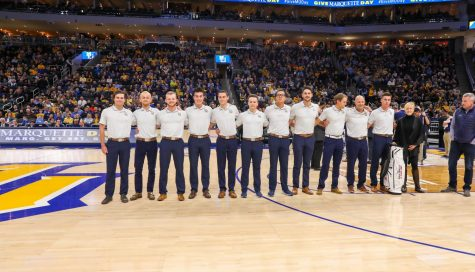 Matt Bachmann (second from left) and the golf team is recognized at the Feb. 26 men