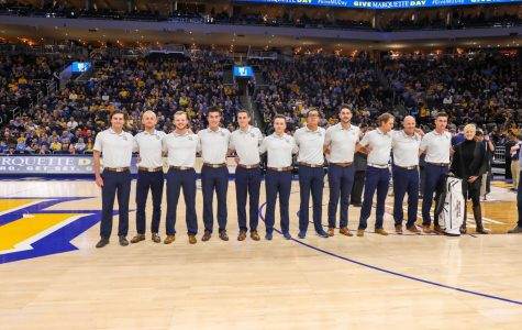 Matt Bachmann (second from left) and the golf team is recognized at the Feb. 26 men's basketball game. (Photo courtesy of Marquette Athletics.)