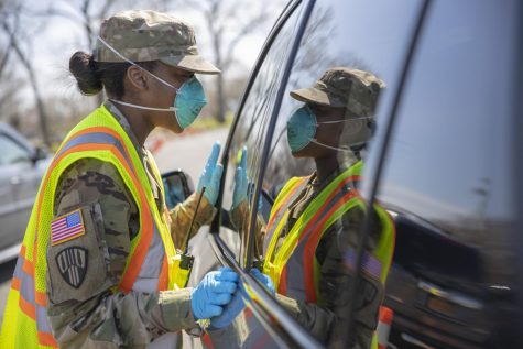New York National Guard member conducts vehicle COVID-19 testing. Photo via Flickr.