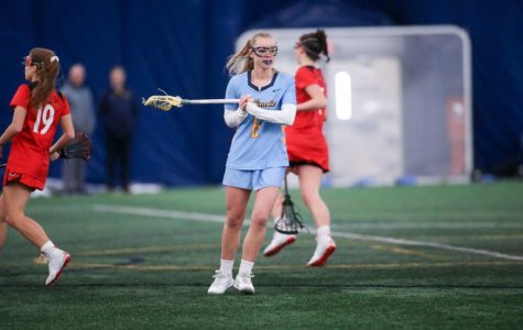 Bridget Danko (center) stands in Marquette's 17-6 win over Cincinnati on Feb. 14. (Photo courtesy of Marquette Athletics.)