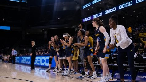 Marquette's bench cheering during the BIG EAST Tournament Championship game March 9.