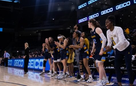 Marquette's bench cheers on the Golden Eagles during MU's loss to DePaul in the BIG EAST Tournament Championship game March 9.