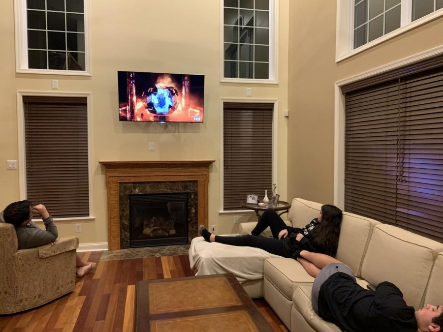 John Leuzzi (left) watches TV with siblings Victoria (top right) and Nick (bottom right) April 29. Photo courtesy of John Leuzzi.