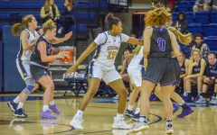 Destiny Strother (13) plays defense in Marquette's 93-47 exhibition win over Winona State on Oct. 26 2019