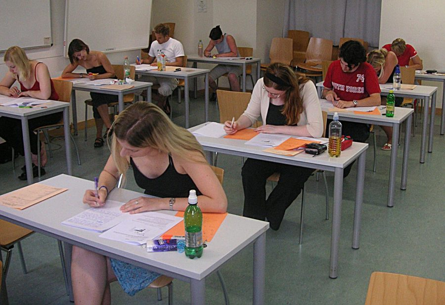 Students taking a test. (Photo via Wikimedia.)